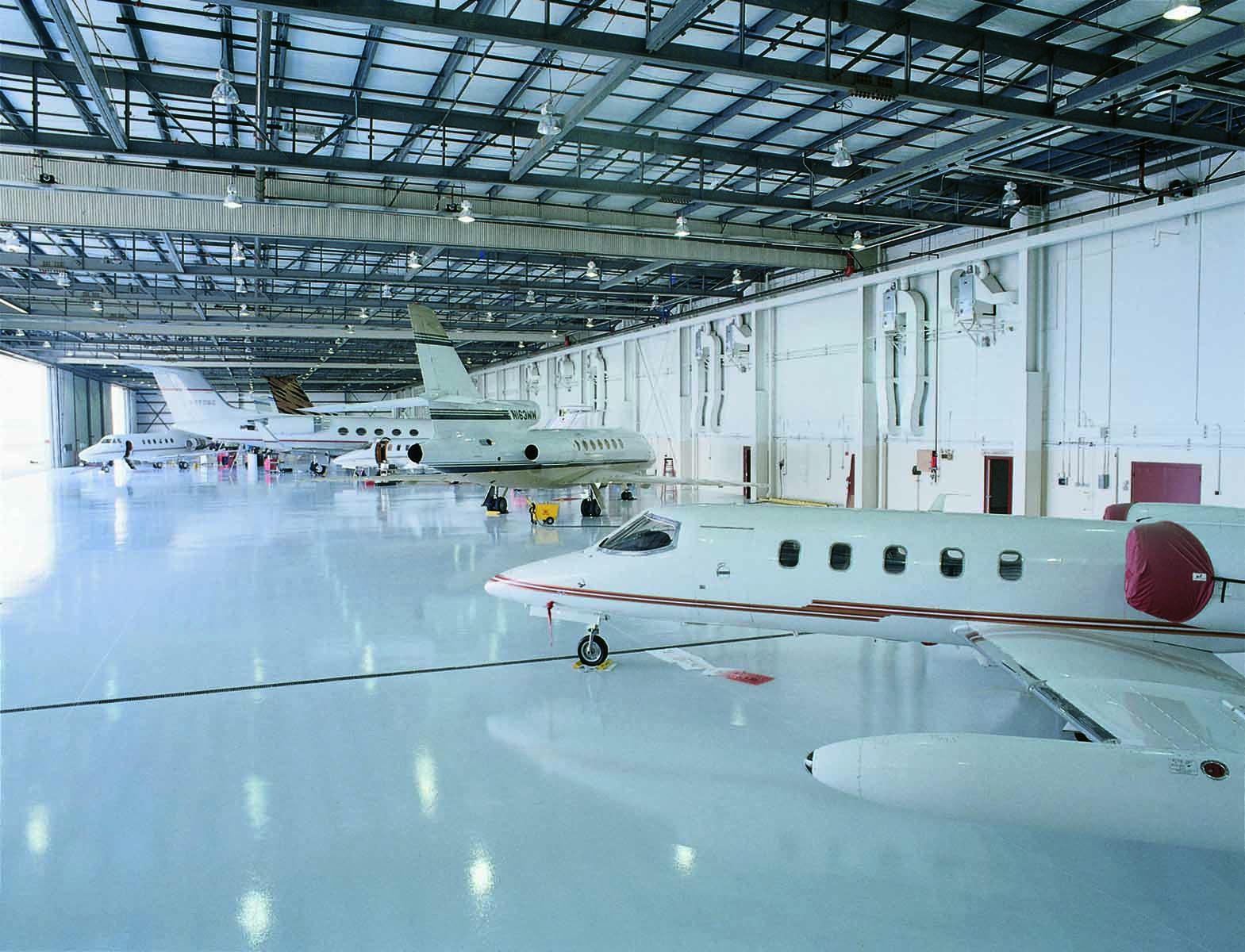 Inside HPN hangar, corporate jets.